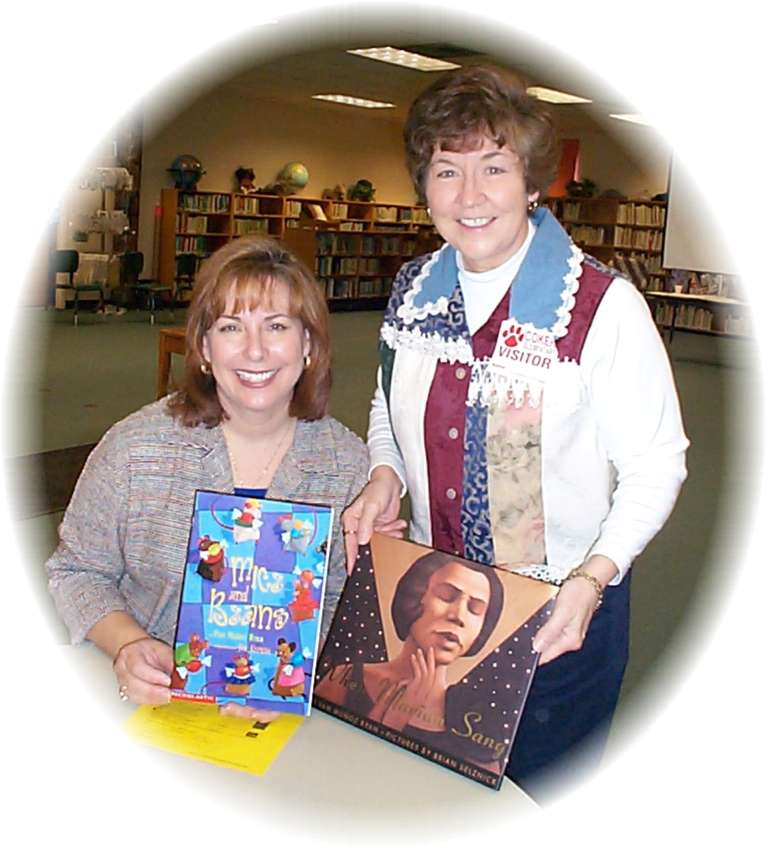Author Pam Munoz Ryan autographs her  books for Suzy Red